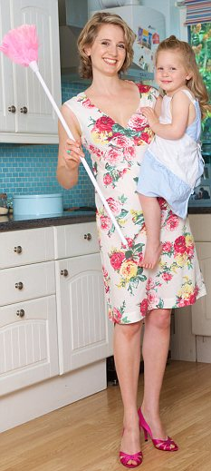 Domestic bliss? Working women also think that their jobs make them better at parenting (file photo)