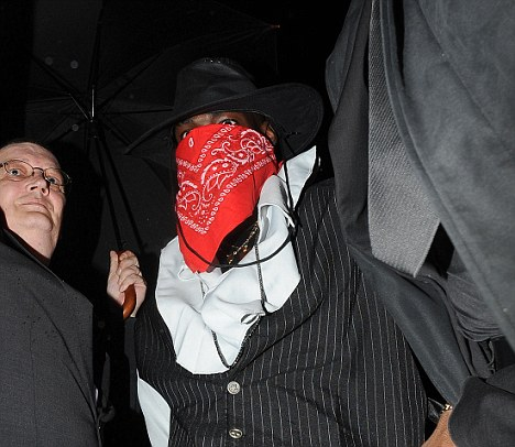 Later on that night: Balotelli put on his bandanna and masqueraded as a bandit