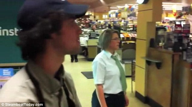 Unhappy: Safeway staff look on aghast as they consider the environmental consequences of bringing three horses into a supermarket