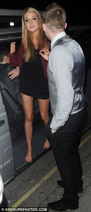 Having a row: The barefoot female was spotted standing near police and then talking with Jonjo