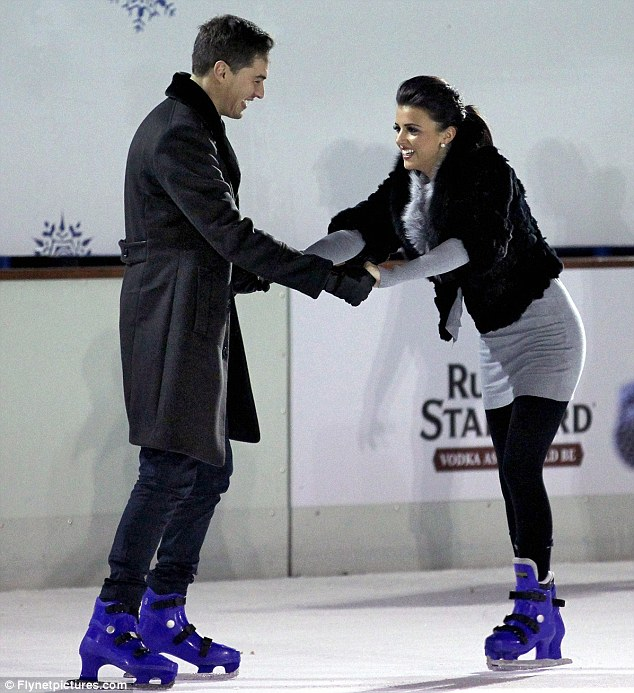 Don't let me go: Mario laughs as Lucy tries to stabilize herself on the slippery ice