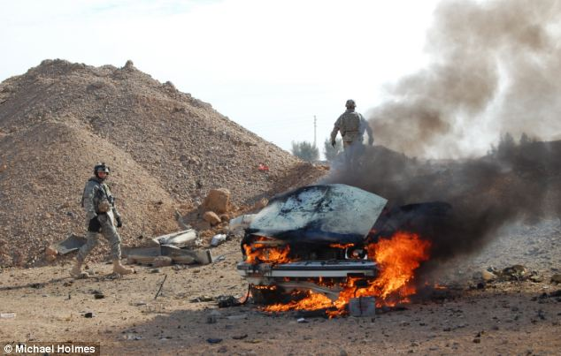 Lawlessness: Mr Holmes frequently saw vehicles burning at the roadside during the conflict