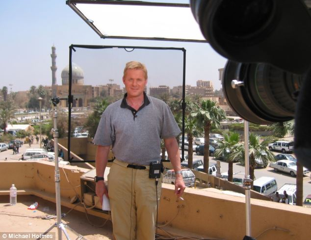 Heart of the action: Mr Holmes in the CNN crew's live broadcast position after the fall of Baghdad