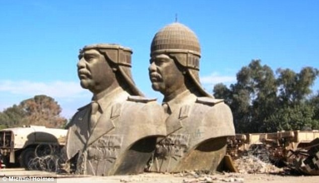 Bitter end: Saddam Hussein statues are removed from The Republican Palace