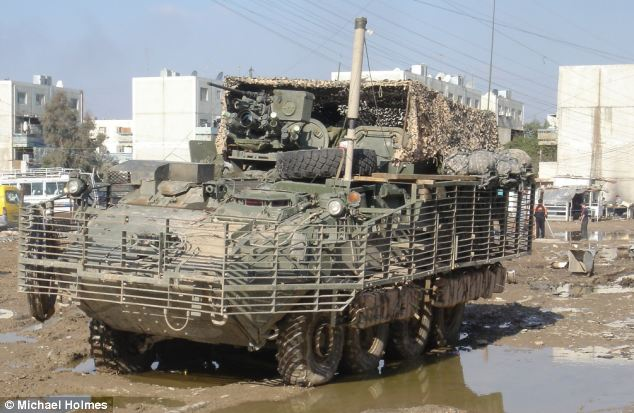 Fences: A U.S. Stryker vehicle with 'pre-detonation screens' around it, designed to make a round explode a few inches off the main armour