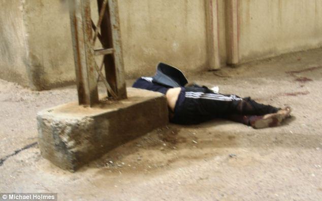Frightening: An unidentified man's body lies abandoned on the ground