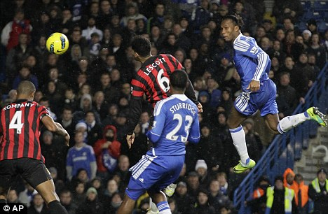 Hitting the heights: Didier Drogba (right) has been in fine form for Chelsea in the past few weeks but he will be away at the Africa Cup of Nations in January