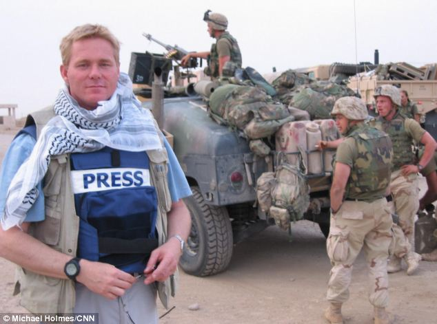 Trepidation: Michael Holmes - seen in a flak jacket - entered Baghdad in 2003 to a reception that ranged from suspicious to joyful