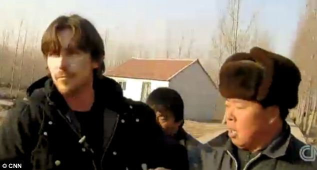 Man-handled: Christian Bale was roughed up by Chinese security guards as he attempted to visit a blind legal activist whose detention has sparked an international outcry