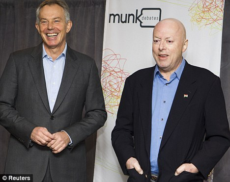 Changing camps: Christopher, right, with former British prime minister Tony Blair in Toronto last year, supported the Iraq war, much to the shock of his left-wing political friends