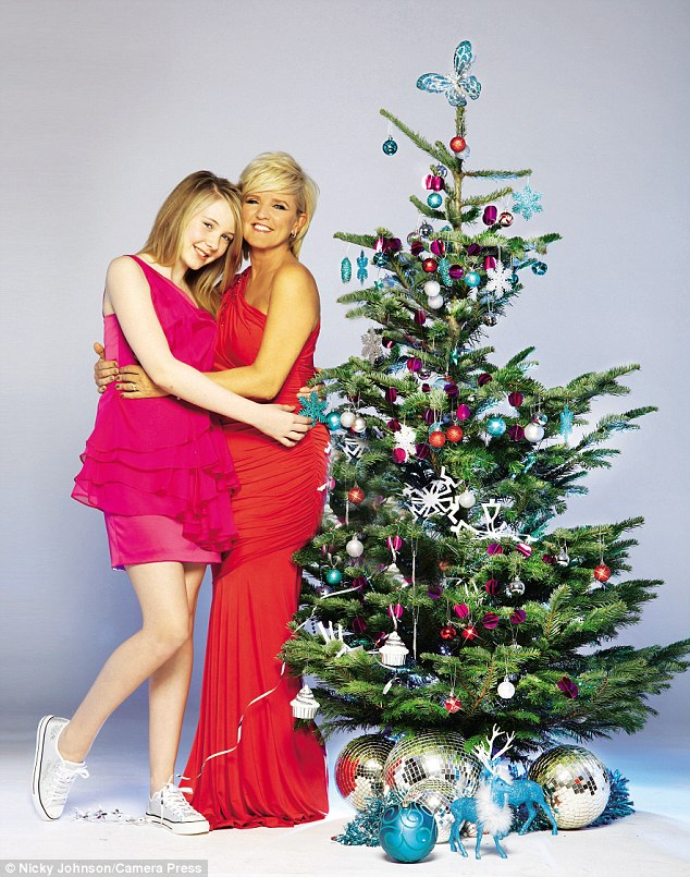Hugging around the Christmas tree: Bernie snuggles in to Erin as she spoke about the amazing Christmas she has planned this year