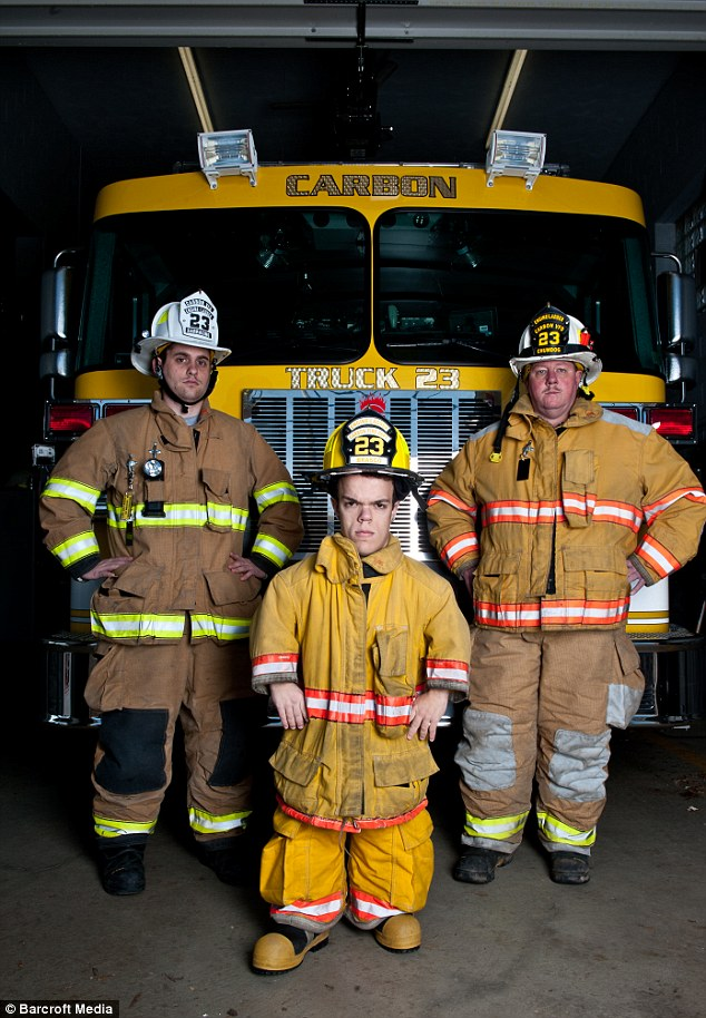 Tiny teen: Vince, centre, is just 19 years old but is undeterred by his small frame as he volunteers as a firefighter