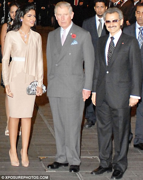 Regal company: Prince Alwaleed bin Talal (right) with his wife Princess Amira and Prince Charles at the reopening of the newly refurbished Savoy Hotel, which the Saudi billionaire owns