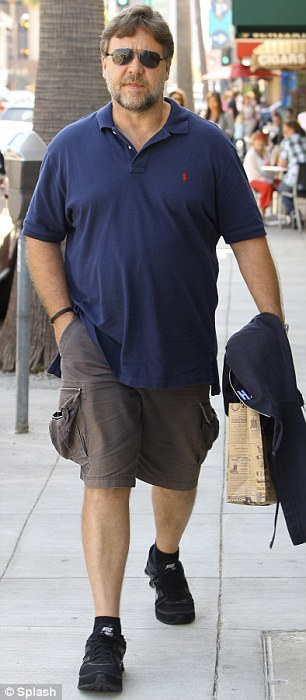 Half the man he used to be: Russell Crowe's spectacular weight loss was obvious as he strolled around in Sydney, Australia yesterday compared to six months ago
