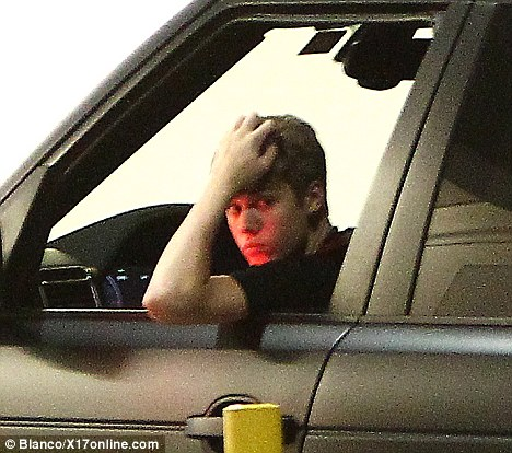Downcast: Selena Gomez's boyfriend Justin Bieber was spotted paying a visit to Gomez's mother in hospital yesterday