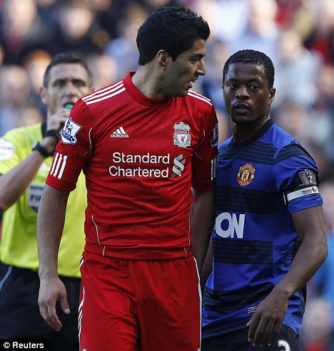 Row: Luis Suarez (left) and Patrice Evra clashed as United and Liverpool drew