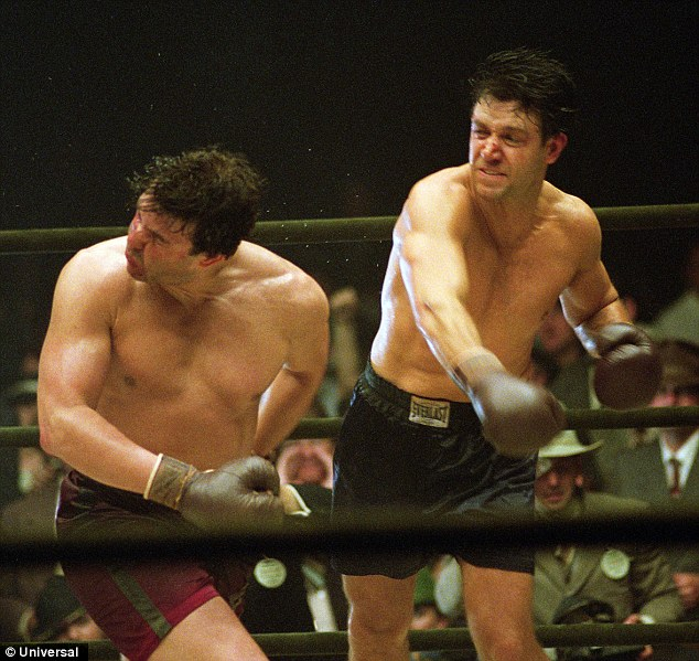 Not packing a paunch: Russell trained hard to be in peak condition to play hard hitting boxer James Braddock in 2005's Cinderella Man