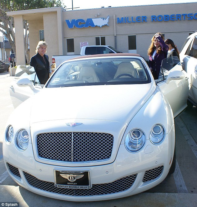 Nice car: No wonder Lisa and her husband were grinning as they made some rounds in their sporty Bentley