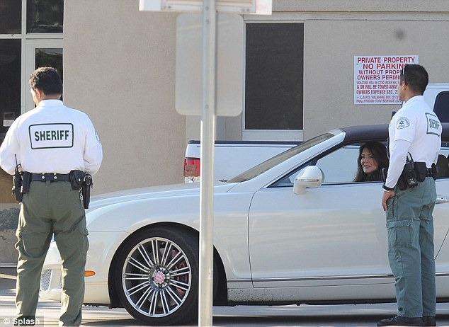 Strong arm of the law: Lisa Vanderpump had to put the brakes on her wheels of steel after being pulled over in Beverly Hills yesterday