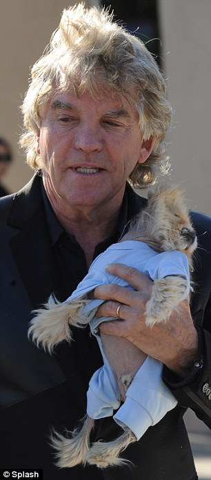 Ruff justice: Perhaps the lawman was swayed into not dishing out any penalties after seeing their cute pooch