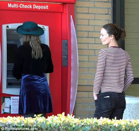 Down-to-earth: Vanessa lining up to withdraw some cash from an ATM