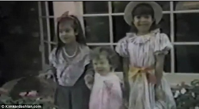 All grown up: The video features a photo of Kourtney, Kim and Khloe from 1985