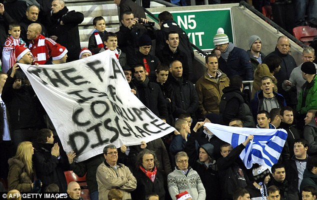 Making their point: Liverpool fans hold up a banner before kick-off