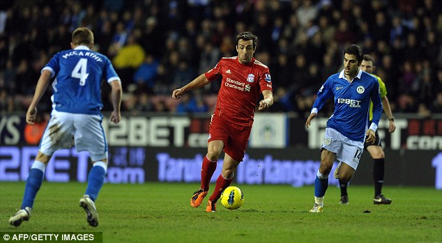 Breaking through: Luis Enrique parts Wigan's midfield