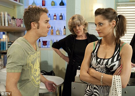 Fiery: Lane as Kylie Platt in a scene from Coronation Street with on-screen husband David (Jack P Shepherd) and his grandmother Audrey Roberts (Sue Nicholls)