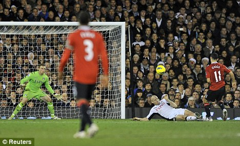 Three and easy: Giggs scores United's third goal at Craven Cottage