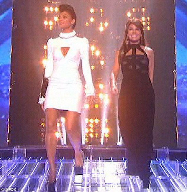 Sexy ladies: Nicole Scherzinger and Paula Abdul arrive on stage for part one of this week's X Factor USA grand finale. Nicole looked sexy in a white keyhole dress while Paula went for a long black dress