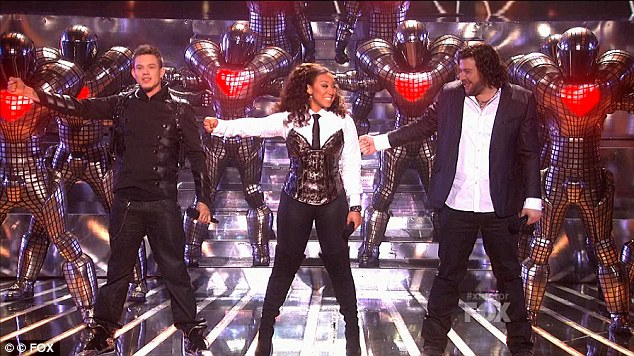 Crunch time: It was crunch time on the X Factor tonight, as the final three finalists, left to right Chris Rene, Melanie Amaro and Josh Krajcik had their last chances to wow both the judges and the public