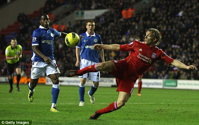 Going close: Dirk Kuyt threatens the Wigan rearguard