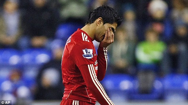 Under fire: Luis Suarez drew a blank in front of goal just 24 hours after being handed a racism ban