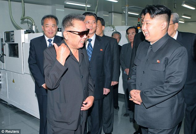 Happy families: Kim Jong Il (left) and Kim Jong Un (right) visit Mokran Video Company in Pyongyang in 2010