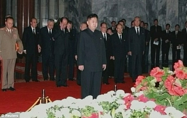 Mourning: Kim Jong Un pictured paying his respects to his father earlier this week