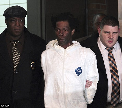 Suspect: Handyman Jerome Isaac (centre) is accompanied by detectives following his arrest at the weekend