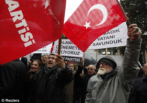 Fury: Protesters outside the consulate in Istanbul. Turkey has withdrawn its ambassador and promised further action after the bill was passed today