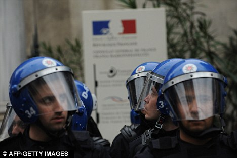 Backlash: Turkish riot police stand guard in front of the French Consulate in Istanbul after France approved a bill which would make it illegal to deny the mass killing of Armenians in 1915 by Ottoman Turks was genocide