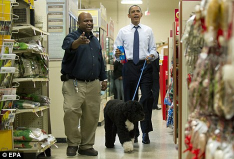 First Dog: President Barack Obama shops for Christmas presents with his dog Bo at PetSmart in Alexandria, Virginia, on Wednesday