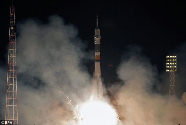 Blast off: The Russian Soyuz rocket booster lifting off this week to carry three astronauts to the International Space Station. However, the launch today was not successful