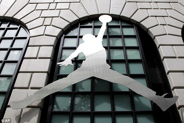 High demand: The shoes named for Jordan by global sportswear manufacturer Nike are still generate huge sales years after the retirement of the NBA legend, who now owns the NBA's Charlotte Bobcats
