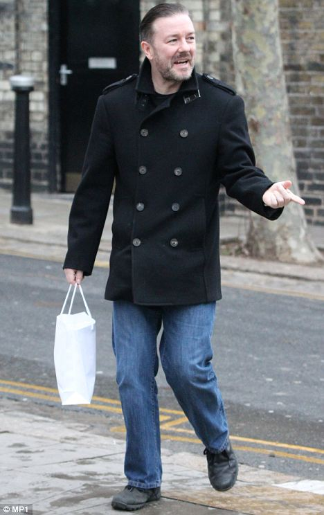 Unapologetic: Ricky Gervais out and about in Primrose Hill in jeans and donkey jacket today