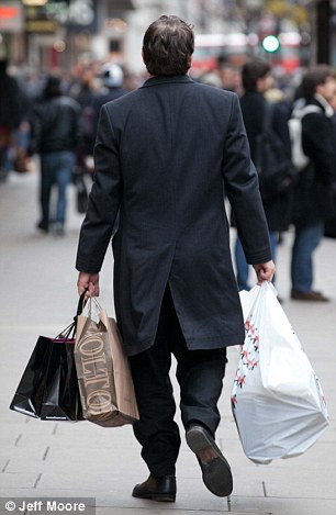 A last minute Christmas shopper grabs a bargain on Oxford Street