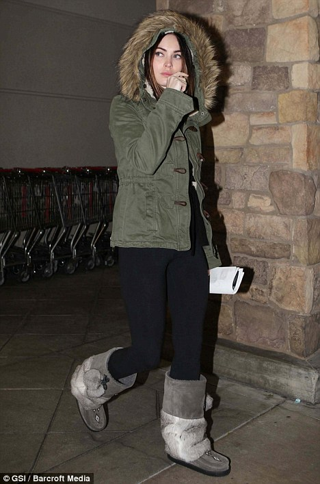 Feeling festive: The actress looked winter-ready in a fur-lined coat and furry Ugg boots