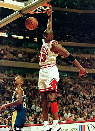 Michael Jordan #23 of the Chicago Bulls dunks the ball during the game against the Golden State Warriors at the United Center in Chicago, Illinois. The Bulls defeated the Warriors 110-87
