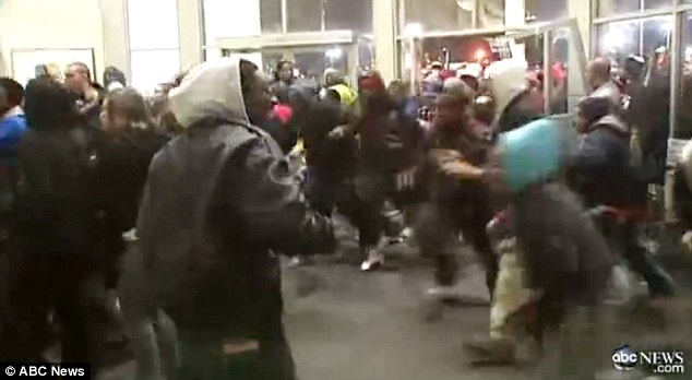Madness: The front doors of Lafayette Square Mall in Indianapolis, Indiana, were broken off their hinges at 7am as shoppers ran inside and several people were knocked over in the mad rush for new Air Jordans