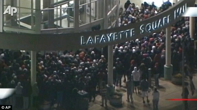 Outside: This image gives an idea of the huge number of people trying to get into Lafayette Square Mall