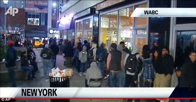 Queue: Shoppers wait to get their hands on the latest brand of the famous shoes outside a New York store