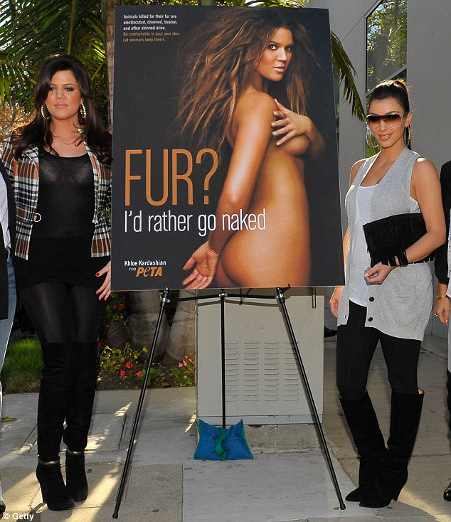 Bottoms up: Kim Kardashian no doubt enjoyed a celebratory drink to toast her sister's PETA campaign poster in 2008